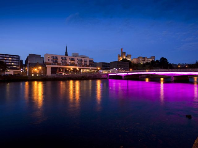 The view across the River Ness to Inverness Castle in the city centre of Inverness, shot at dusk